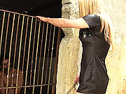 TS Mistress dominates her caged slave